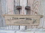 Vintage Looking Coffee Stained Feed and Seed Grow Better Crops Feed Sack Lathe Wall Hanging