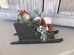Primitive Black Wooden Sleigh With Snowballs Pine and Berries