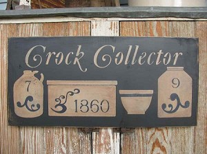 Primitive Crock Collector with Stoneware Crocks Jugs and Bowl Hand Painted Sign