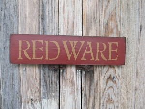 Red Brick Background with Olde Forge Mustard Lettering